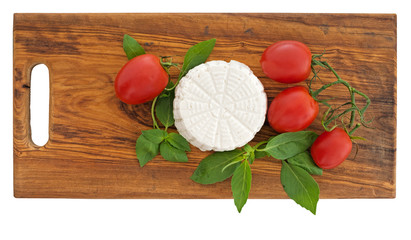 Fresh artisan ricotta cheese tomatoes, basil.