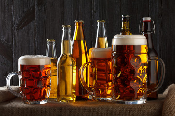 Assortment of beer glasses on table