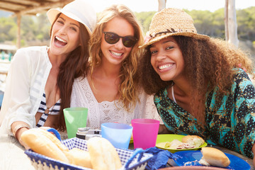 Group Of Female Friends Enjoying Lunch Outdoors