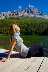 Beautiful woman in vacation enjoying mountain and lake