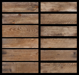 Set of vintage weathered wooden planks isolated on black