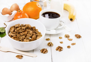 Breakfast with muesli over white wooden background