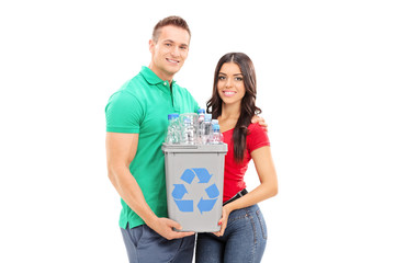 Young couple holding a recycle bin