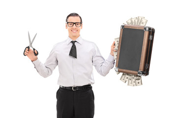 Businessman with cut tie holding bag full of money