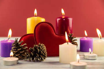 fir-tree cones and candles on a wooden background