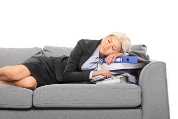 Businesswoman sleeping on a pile of documents