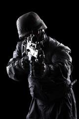 Spec ops soldier on black background