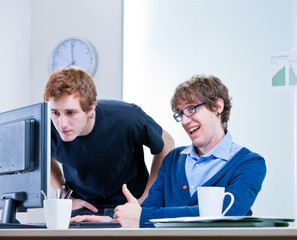 young men working together in an office