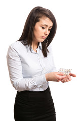 Ill young office worker taking pills
