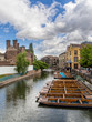 Punts lined up on river in  Cambridge England - 71480741