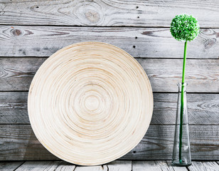 beautiful vase on a wooden plate with a flower