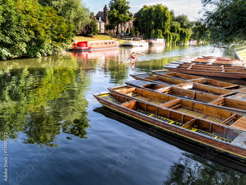 Punts lined up on river in  Cambridge England - 71480722