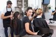 Leinwanddruck Bild - Hairdressers working on their clients
