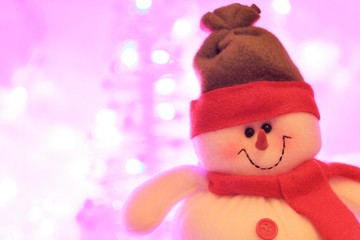 Smiling snowman against christmas lights