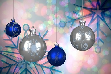 Composite image of blue and silver christmas baubles