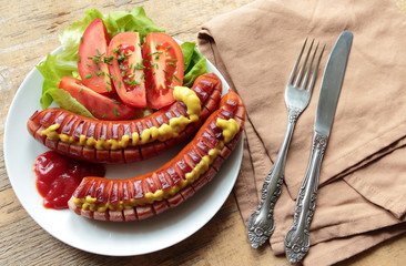 Grilled sausages with fresh tomatoes with chive