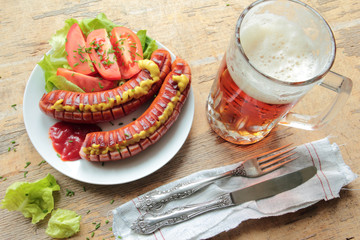 Grilled sausages with vegetables and cold beer on barbecue