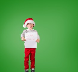 Composite image of festive boy showing letter