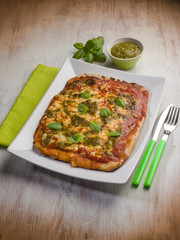 homemade pizza with pesto sauce