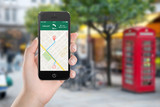 Map gps navigation application on the smartphone screen in femal hand