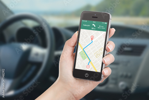 Smartphone with map gps navigation application on the screen in car - 71482912