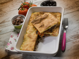 focaccia stuffed with black olives tomatoes and anchovies