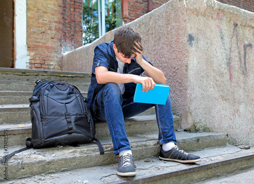 Sad Student with the Book - 71483575