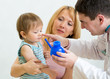 Pediatrician counseling mother and her son about nasal irrigatio