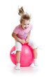 happy child jumping on bouncing ball. Isolated on white