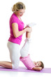 woman and kid daughter doing gymnastic exercise at mat