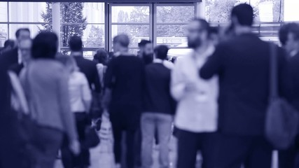 blurred trade fair visitors