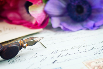 quill pen and antique letters with flowers