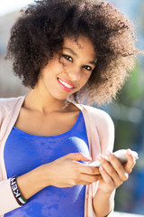 Afro woman using mobile phone