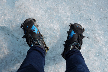 Hiking boots with crampon on Ice