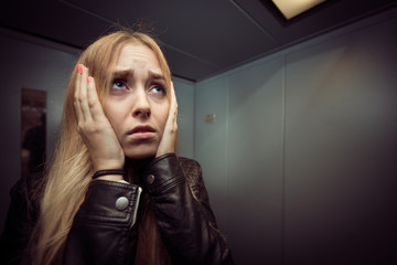 anxious young blonde woman