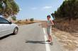young boy hitchhiking