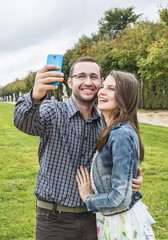 Happy Couple taking a selfie in a French Garden