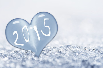 2015, close up on a ice heart in the snow