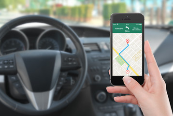 Smartphone with map gps navigation app on the screen in female h