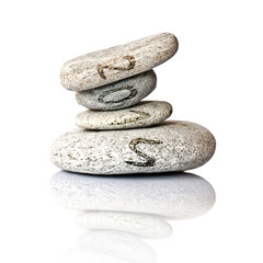 2015 written on stack of pebbles isolated on white background