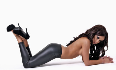Redhead glamour model in black leather