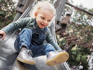 Little girl on the slide