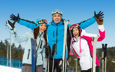 Half-length portrait of group of alpine skier friends
