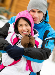 Half-length portrait of hugging couple during winter vacations