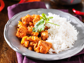 indian chicken vindaloo curry with basmati rice close up