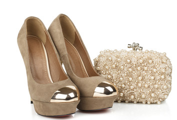 isolated women beige suede shoes with clutch bag