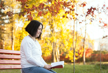 mature woman reading in park