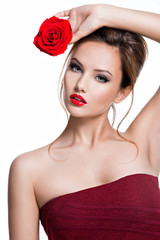 Beautiful woman with red rose in hands.