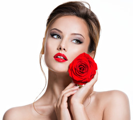 Closeup face of beautiful woman with red rose  bright makeup