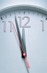Clock hitting 12 O'clock